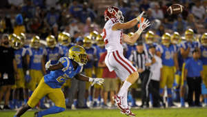 Oklahoma wide receiver Drake Stoops, right, makes a catch as UCLA defensive back Jay Shaw defends during the second half of an NCAA college football game Saturday, Sept. 14, 2019, in Pasadena, Calif. (AP Photo/Mark J. Terrill)
