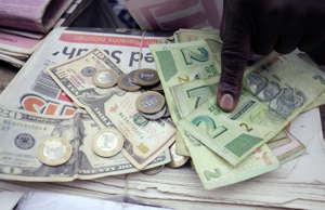 Zimbabwe lifts interest rates to 70% as its currency plunges