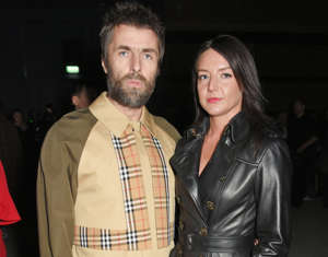 LONDON, ENGLAND - FEBRUARY 17: Liam Gallagher (L) and Debbie Gwyther wearing Burberry at the Burberry February 2018 show during London Fashion Week at Dimco Buildings on February 17, 2018 in London, England. (Photo by David M. Benett/Dave Benett/Getty Images for Burberry)