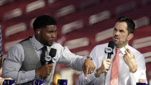 Former Southern California players Reggie Bush, left, and Matt Leinart rehearse for a pregame show, at an NCAA college football game between Southern California and Utah on Friday, Sept. 20, 2019, in Los Angeles. (AP Photo/Marcio Jose Sanchez)