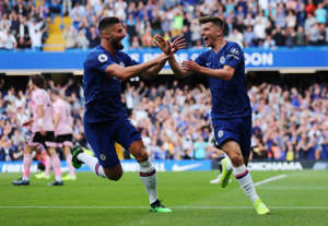 "Soccer Football - Premier League - Chelsea v Leicester City - Stamford Bridge, London, Britain - August 18, 2019  Chelsea's Mason Mount celebrates scoring their first goal with teammate Olivier Giroud   REUTERS/Eddie Keogh  EDITORIAL USE ONLY. No use with unauthorized audio, video, data, fixture lists, club/league logos or ""live"" services. Online in-match use limited to 75 images, no video emulation. No use in betting, games or single club/league/player publications.  Please contact your account representative for further details."