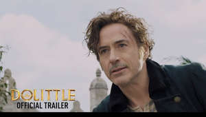 Robert Downey Jr. looking at the camera: He's just not a people person. Watch the trailer for #DolittleMovie, in theaters January 17. -- Facebook: unvrs.al/DolittleFB Twitter: unvrs.al/DolittleTW Instagram: unvrs.al/DolittleIG Site: unvrs.al/DolittleSite -- Robert Downey Jr. electrifies one of literature's most enduring characters in a vivid reimagining of the classic tale of the man who could talk to animals: Dolittle.   After losing his wife seven years earlier, the eccentric Dr. John Dolittle (Downey), famed doctor and veterinarian of Queen Victoria's England, hermits himself away behind the high walls of Dolittle Manor with only his menagerie of exotic animals for company.   But when the young queen (Jessie Buckley, Wild Rose) falls gravely ill, a reluctant Dolittle is forced to set sail on an epic adventure to a mythical island in search of a cure, regaining his wit and courage as he crosses old adversaries and discovers wondrous creatures.   The doctor is joined on his quest by a young, self-appointed apprentice (Dunkirk's Harry Collett) and a raucous coterie of animal friends, including an anxious gorilla (Oscar® winner Rami Malek), an enthusiastic but bird-brained duck (Oscar® winner Octavia Spencer), a bickering duo of a cynical ostrich (The Big Sick*'s Kumail Nanjiani) and an upbeat polar bear (John Cena, *Bumblebee) and a headstrong parrot (Oscar® winner Emma Thompson), who serves as Dolittle's most trusted advisor and confidante.   The film also stars Antonio Banderas, Michael Sheen (The Queen) and Oscar® winner Jim Broadbent and features additional voice performances from Oscar® winner Marion Cotillard, Frances de la Tour, Carmen Ejogo, Ralph Fiennes, Selena Gomez, Tom Holland, and Craig Robinson.   Directed by Academy Award® winner Stephen Gaghan (Syriana, Traffic), Dolittle is produced by Joe Roth and Jeff Kirschenbaum under their Roth/Kirschenbaum Films (Alice in Wonderland, Maleficent) and Susan Downey (Sherlock Holmes franchise, The Judge) for Team Downey. The film is executive produced by Robert Downey Jr., Sarah Bradshaw (The Mummy, Maleficent) and Zachary Roth (Maleficent: Mistress of Evil).