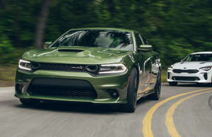 America's leading (and only) V-8 muscle sedan takes on Korea's upstart rear-drive hatchback in a battle of power versus poise.