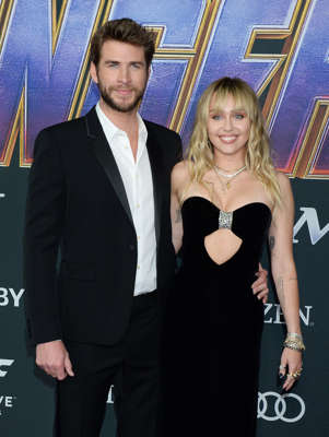 "Liam Hemsworth, Miley Cyrus posing for the camera: For some celebs, wedded bliss isn't all it's cracked up to be. Join Wonderwall.com as we take a look at the famous couples who dated longer than they were able to stay married... starting with Liam Hemsworth and Miley Cyrus, who announced that they'd split less than eight months after they said ""I do."" The pair, who were together on and off spanning more than a decade (and were previously engaged in 2012 before breaking up in 2013), confirmed their separation in August 2019 a day after Miley -- who denied speculation that she'd cheated -- was photographed kissing Kaitlynn Carter while vacationing in Italy. Liam filed for divorce less than two weeks later, citing irreconcilable differences. Keep reading for more..."