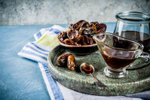 Date honey with dried dates, Jewish national sweet food, copy space