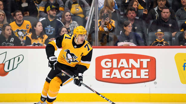 PITTSBURGH, PA - OCTOBER 05: Pittsburgh Penguins Center Evgeni Malkin (71) skates with the puck during the first period in the NHL game between the Pittsburgh Penguins and the Columbus Blue Jackets on October 5, 2019, at PPG Paints Arena in Pittsburgh, PA. (Photo by Jeanine Leech/Icon Sportswire via Getty Images)