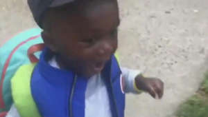 Young boy recites positive affirmation on his way to school
