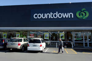 Kerikeri, New Zealand - August 11, 2013: Man walks in front of Countdown supermarket on August 11, 2013. It's the flagship brand of Woolworth's New Zealand supermarket subsidiary. It's the nation's largest supermarket chain with with over 160 supermarkets.