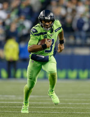 SEATTLE, WA - OCTOBER 03:  Quarterback Russell Wilson #3 of the Seattle Seahawks rushes against the Los Angeles Rams at CenturyLink Field on October 3, 2019 in Seattle, Washington.  (Photo by Otto Greule Jr/Getty Images)