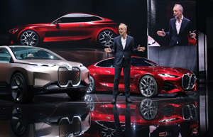 FRANKFURT AM MAIN, GERMANY - SEPTEMBER 10: Adrian van Hooydonk, Senior Vice President at BMW Group Design, speaks while standing next to the new BMW Concept 4 Coupe (in red) during the press days at the 2019 IAA Frankfurt Auto Show on September 10, 2019 in Frankfurt am Main, Germany. The IAA will be open to the public from September 12 through 22. (Photo by Sean Gallup/Getty Images)