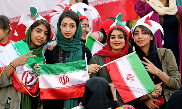 Iranian women pose for a picture ahead of the World Cup Qatar 2022 Group C qualification football match between Iran and Cambodia at the Azadi stadium in the capital Tehran on October 10, 2019. (Photo by ATTA KENARE / AFP) (Photo by ATTA KENARE/AFP via Getty Images)