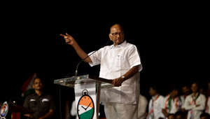 Drenched in rain, Pawar addresses poll rally in Satara