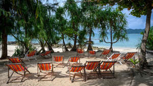 This picture taken on October 2, 2019 shows empty lounge chairs on a beach of Ko Bon island in the Andaman Sea. (Photo by Mladen ANTONOV / AFP) (Photo by MLADEN ANTONOV/AFP via Getty Images)