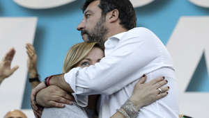 "Giorgia Meloni, left, and Matteo Salvini hug each others during a rally in Rome, Saturday, Oct. 19, 2019. Thousands of protesters are gathering in Rome for a so-called ""Italian Pride"" rally, which brings together the right-wing League of Salvini, the far-right Brothers of Italy of Giorgia Meloni and former premier Silvio Berlusconi's Forza Italia. (AP Photo/Andrew Medichini)"