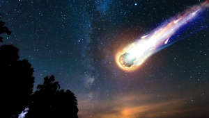 A comet, an asteroid, a meteorite falls to the ground against a starry sky. Attack of the meteorite. Meteor Rain. Kameta tail. End of the world. Astranomy.
