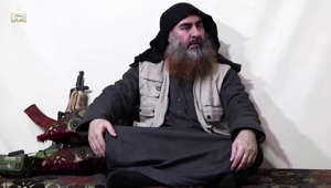 Abu Bakr al-Baghdadi wearing a suit and tie