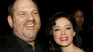 Harvey Weinstein, Rose McGowan are posing for a picture