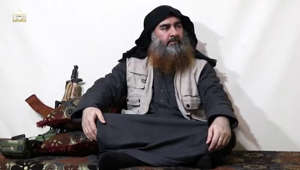Abu Bakr al-Baghdadi sitting in a chair