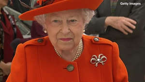 Elizabeth II wearing a red hat