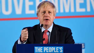 Boris Johnson wearing a suit and tie and holding a sign: Prime Minister Boris Johnson hails victory in UK general elections adding that the UK will leave EU on January 31.