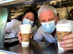 a person holding a cup: The owners of Get Goes Mobile Cafe, Jeff and Zeva Williams, have been making coffee and espresso drinks for over a decade now.