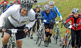 Country Diary : Battling up Hardknott in the Fred: Cyclists battle up Hardknott in the Fred Whitton Challenge. Photograph: Tony Greenbank