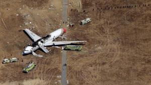 The Asiana Boeing 777 lies wrecked on the runway at San Francisco International Airport. Despite several fatal incidents, 2013 was the safest year on record for air travel.