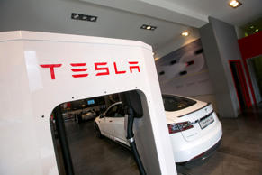 A Tesla Motors Inc. Model S P85 electric automobile stands connected to a charger inside a Tesla store in Munich, Germany, on March 30, 2015.