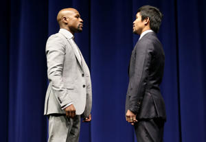 LOS ANGELES, CA - MARCH 11: Floyd Mayweather (L) and Manny Pacquiao face off at the start of their Press Conference promoting their upcoming fight on March 11, 2015 in Los Angeles, California.