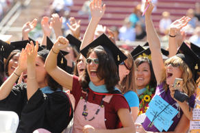 Stanford University graduates cheer for commencement speaker Oprah Winfrey during the 117th graduation on campus in Palo Alto, Calif., Sunday, June 15, 2008. (AP Photo/Ron Lewis)