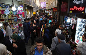 Iranians make their way in Tajrish bazaar northern Tehran, Iran, Tuesday, March ...