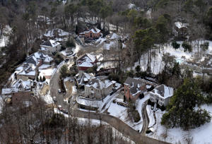 Snow blankets a subdivision in Mountain Brook, Ala., on Wednesday, Jan. 29, 2014, after a winter storm slammed into the South on Tuesday. While such amounts of accumulation barely quality as a storm in the north, it was enough to paralyze the Deep South. (AP Photo/David Tulis)