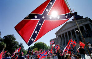 Confederate flag supporters demonstrate on the north steps of the capitol building April, 6, 2000, in Columbia, SC.
