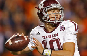 Texas A&M quarterback Kyle Allen (10) sets back to throw the ball against Auburn during the second half of an NCAA college football game Saturday, Nov. 8, 2014, in Auburn, Ala.