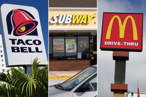Signs for (from left) Taco Bell, McDonald's & Subway restaurants