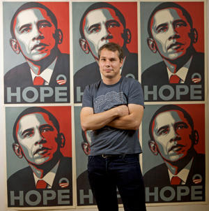 Los Angeles street artist Shepard Fairey poses in front of the Barack Obama Hope artwork he designed in the Echo Park area of Los Angeles.