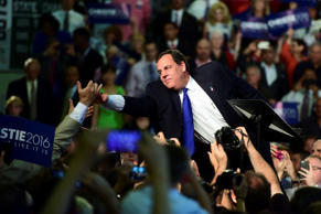 Chris Christie, governor of New Jersey, reaches out to greet a supporter at Livingston High School in Livingston, New Jersey, U.S., on Tuesday, June 30, 2015.