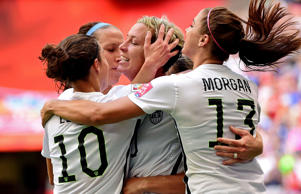 United States forward Abby Wambach, center, is congratulated by midfielder Carli Lloyd, left, and forward Alex Morgan after scoring against Nigeria during the first half in a Group D soccer match at BC Place Stadium on June 16, 2015, in Vancouver.