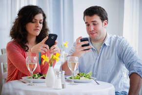 Couple text messaging. Jamie Grill/Getty Images
