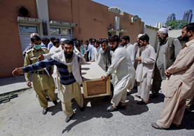 File: Pakistanis carry the casket of their relative, a victim of a bomb blast, after receiving him from a morgue at a local hospital in Islamabad, Pakistan, Wednesday, April 9, 2014.