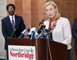 In this Sept. 5, 2014, file photo, California State University, Northridge, CSUN, President Dianne Harrison reads a statement regarding Pi Kappa Phi fraternity activities that lead to the death of CSUN student Armando Villa, at a news conference at the CSUN campus in Northridge, Calif.