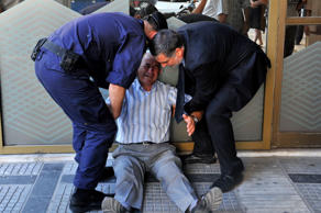 File: Demonstrator is arrested by riot policemen during a protest against the visit to Greece by Germany's Chancellor Angela Merkel in Athens, October 9, 2012.
