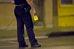 File photo of member of the Chicago Police Department with an evidence marker at the scene of a fatal shooting.