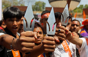 File: Supporters of the radical Vishwa Hindu Parishad (VHP) Hindu group hold tridents as they take part in their workers' meet in the western Indian city of Ahmedabad March 31, 2013.