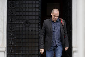 Greek Finance Minister Yanis Varoufakis leaves Maximos Mansion in Athens. Varoufakis resigned on Monday, July 6, 2015 saying he was told shortly after the Greek referendum result that the some eurozone finance ministers and Greece's other creditors would prefer he not attend the ministers' meetings.