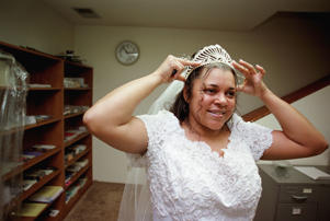 Bride adjusting tiara before wedding ceremony