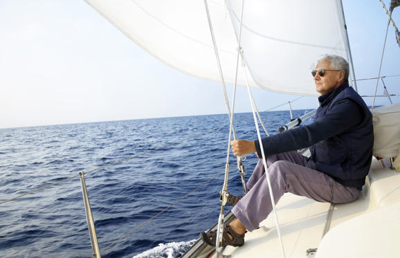 Senior man on a sailboat.