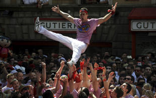 A man is tossed in the air by the crowd.