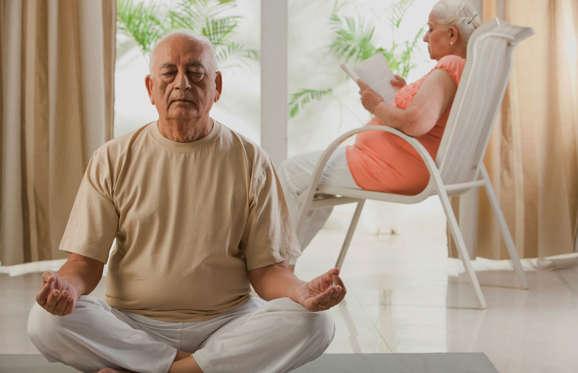 Senior man practicing yoga.
