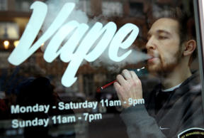 Eric Scheman demonstrates an e-cigarette at Vape store in Chicago.